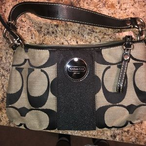 Coach purse with the detachable cross body strap